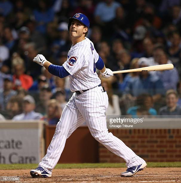 Chicago Cubs first baseman Anthony Rizzo watches the flight of his fly ball during the third inning against the San Diego Padres at Wrigley Field in...