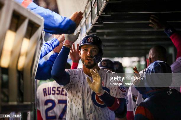 Chicago Cubs first baseman Kris Bryant celebrates with other players after hitting an RBI home run, bringing in Chicago Cubs center fielder Albert...