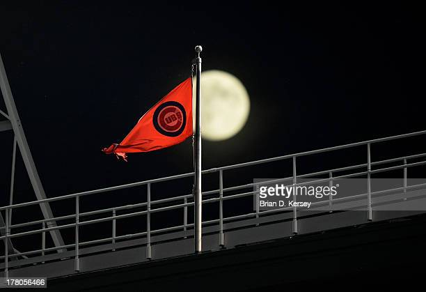 Chicago Cubs flag flies from the roof of Wrigley Field during the game against the Washington Nationals on August 19 2013 in Chicago Illinois The...