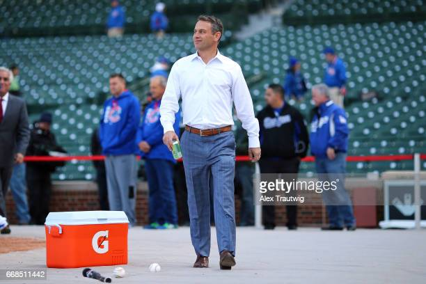 Chicago Cubs General Manager Jed Hoyer walks on the field ahead of the game between the Los Angeles Dodgers and the Chicago Cubs at Wrigley Field on...