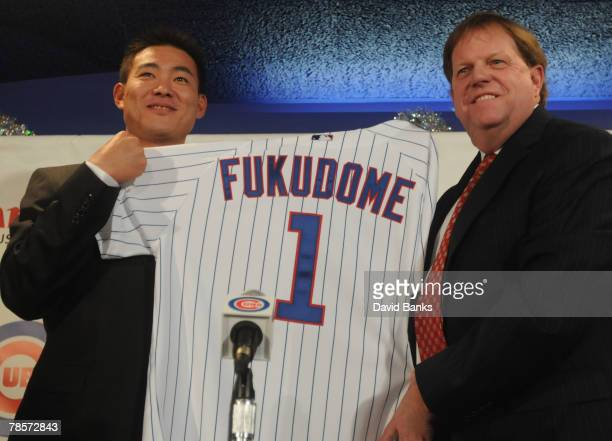 Chicago Cubs general manager Jim Hendry introduces Japanese Baseball player Kosuke Fukudome as their new outfielder at Wrigley Field December 19 2007...