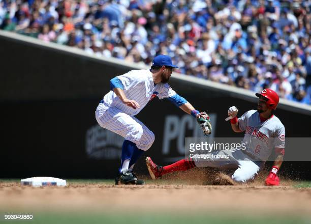Chicago Cubs infielder Ben Zobrist applies the tag as the Cincinnati Reds' Billy Hamilton is caught stealing second base in the third inning at...