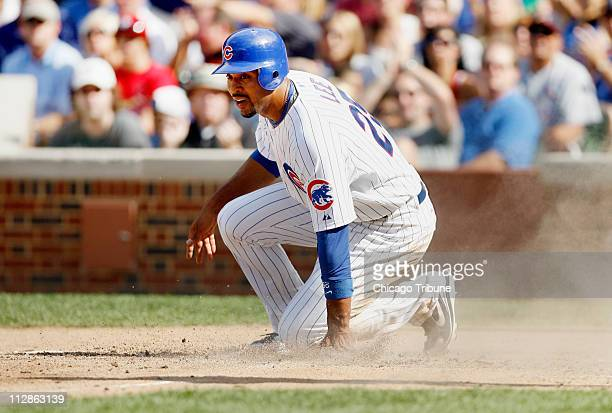 Chicago Cubs infielder Derrek Lee slides into home plate for a run during game action against the St Louis Cardinals The Cubs defeated the Cardinals...
