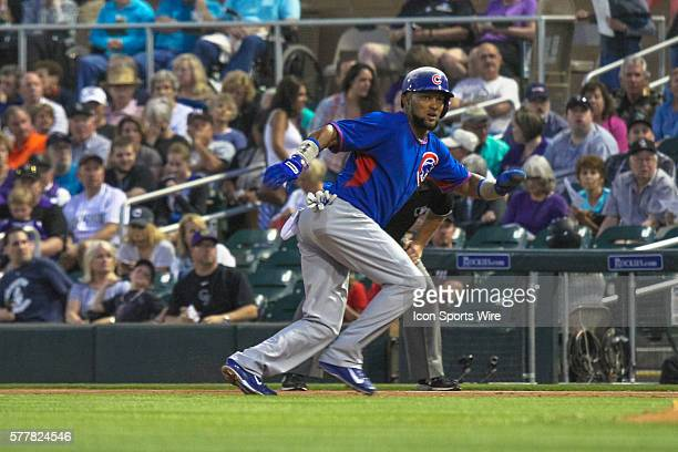 Chicago Cubs infielder Emilio Bonifacio gets back to first base just before the pickoff attempt during the Spring Training game between the Chicago...