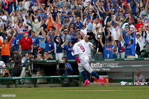 Chicago Cubs' Javier Baez hits a solo homer during the 13th inning to win the game for the Cubs against the Washington Nationals on Sunday May 8 at...