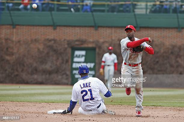 Chicago Cubs' Junior Lake is forced out at second base as Philadelphia Phillies shortstop Jimmy Rollins is unable to make the throw for a double play...