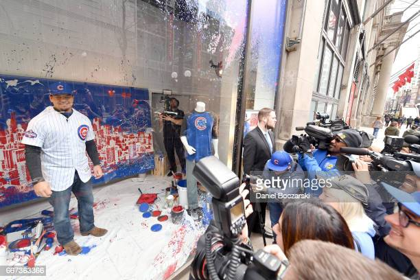 Chicago Cubs' Kyle Schwarber surprises shoppers in window display at Macy's on State Street before his meet and greet with fans instore with Locker...