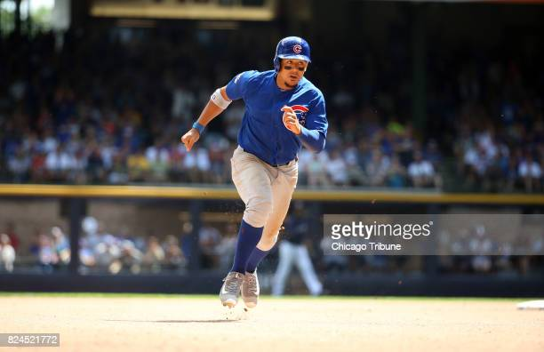 Chicago Cubs left fielder Jon Jay advances to third base on a double by Kris Bryant in the sixth inning against the Milwaukee Brewers on Sunday July...