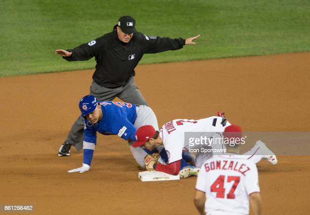 Chicago Cubs left fielder Jon Jay beats the throw to Washington Nationals shortstop Trea Turner and is safe at second base during game five of the...