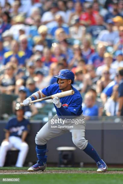 Chicago Cubs left fielder Jon Jay bunts during a game between the and the Chicago Cubs the Milwaukee Brewers on September 23 at Miller Park in...