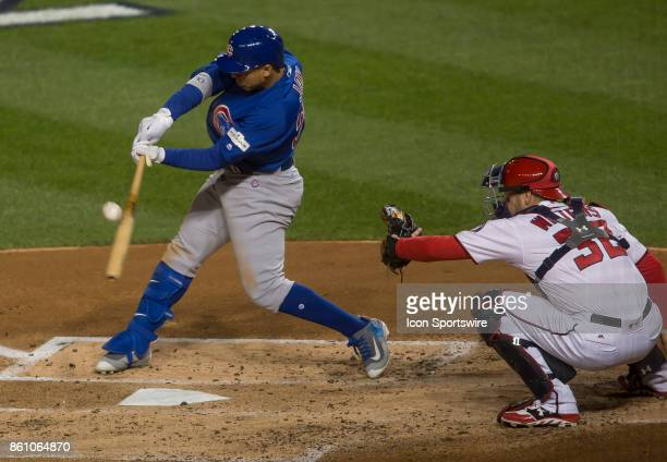 Chicago Cubs left fielder Jon Jay makes contact during game five of the NLDS between the Washington Nationals and the Chicago Cubs on October 12 at...