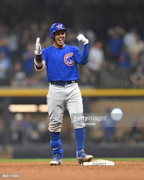 Chicago Cubs left fielder Jon Jay reacts after hitting a double in the tenth inning during a game between the and the Chicago Cubs the Milwaukee...