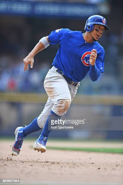 Chicago Cubs left fielder Jon Jay rounds third base during a game between the and the Chicago Cubs the Milwaukee Brewers on September 23 at Miller...