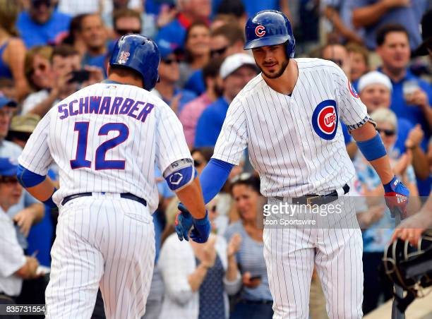 Chicago Cubs left fielder Kyle Schwarber and Chicago Cubs third baseman Kris Bryant celebrate at home plate during the game between the Cincinnati...