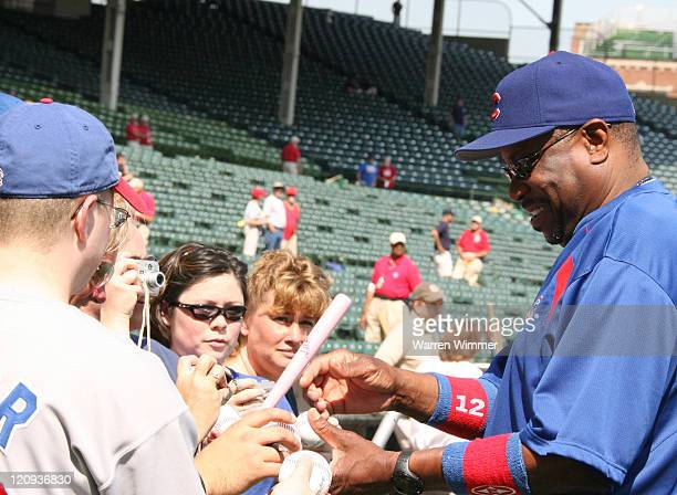 Chicago Cubs manager Dusty Baker signing autographs before the game between the Pittsburgh Pirates and Chicago Cubs at Wrigley Field in Chicago...