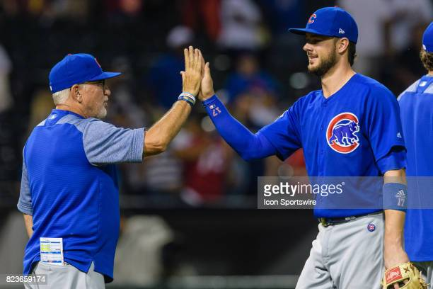 Chicago Cubs manager Joe Maddon and Chicago Cubs third baseman Kris Bryant celebrate a Cubs win after an MLB game between the Chicago Cubs and the...