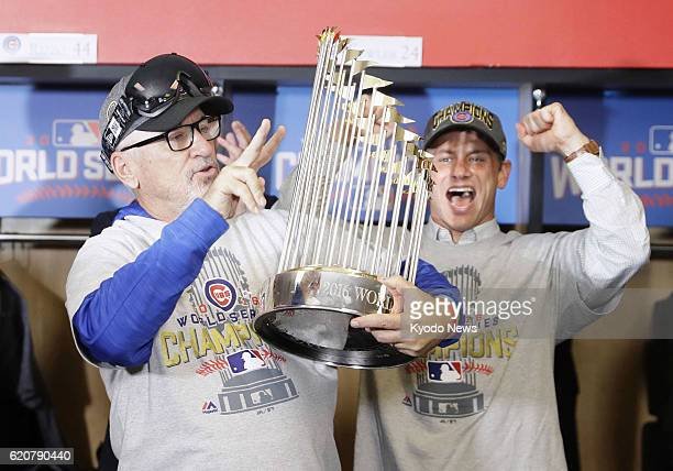 Chicago Cubs manager Joe Maddon celebrates after his team beat the Cleveland Indians 87 in Game 7 of the World Series in Cleveland on Nov 3 to win...