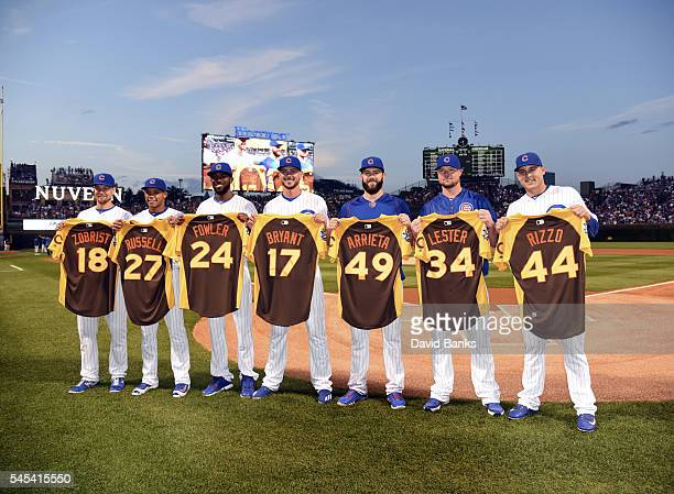 Chicago Cubs National League All Stars Ben Zobrist Addison Russell Dexter Fowler Kris Bryant Jake Arrieta Jon Lester and Anthony Rizzo pose for a...