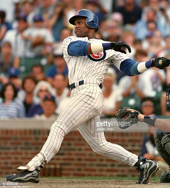 Chicago Cubs outfielder Sammy Sosa hits his 62nd home run of the year in the ninth inning of the Cubs' 1110 victory over the Milwaukee Brewers 13...