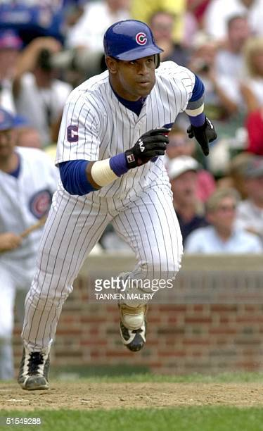 Chicago Cubs outfielder Sammy Sosa takes off after hitting a tripple with the bases loaded, off Montreal Expos pitcher Guillermo Mota in the bottom...