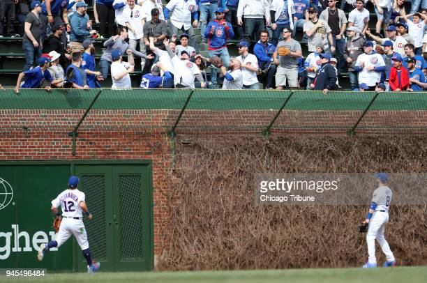 Chicago Cubs outfielders Kyle Schwarber and Ian Happ look up at a home run by the Pittsburgh Pirates' Gregory Polanco in the seventh inning on...