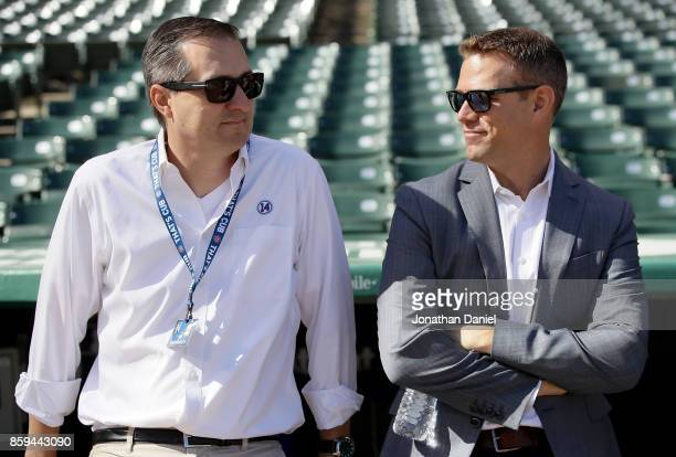 Chicago Cubs owner Tom Ricketts and general manager Theo Esptein look on before game three of the National League Division Series against the...
