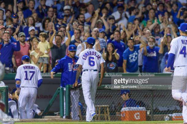 Chicago Cubs pitcher Carl Edwards Jr walks into the dugout after striking out Cincinnati Reds center fielder Billy Hamilton in the 7th inning during...