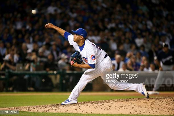 Chicago Cubs pitcher Hector Rondon works during the eighth inning against the Milwaukee Brewers at Wrigley Field in Chicago on Tuesday April 18 2017...