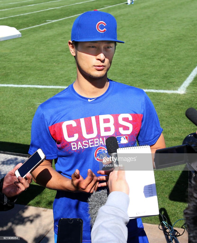 Chicago Cubs pitcher Yu Darvish answers questions from reporters at the team's spring training site in Mesa, Arizona, on Feb. 20, 2018. ==Kyodo
