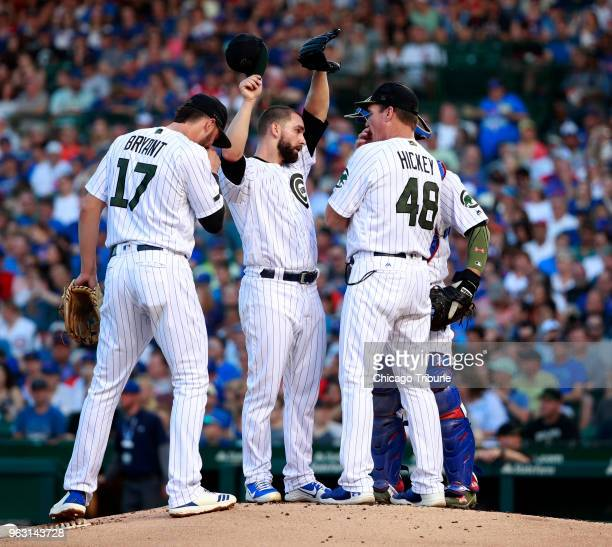 Chicago Cubs pitching coach Jim Hickey speaks with Chicago Cubs starting pitcher Tyler Chatwood after he gave up an RBI single to San Francisco...