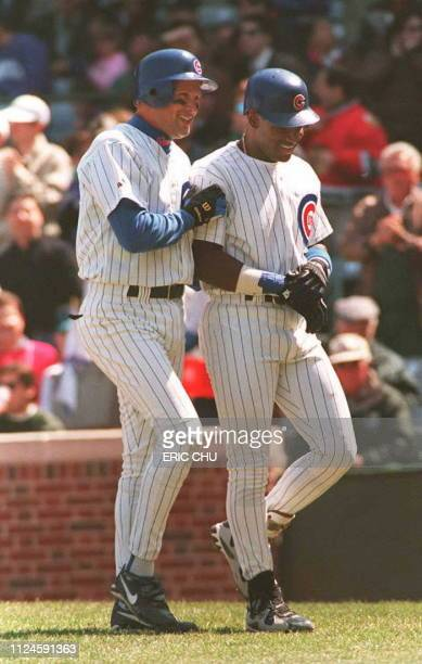 Chicago Cubs player Mark Grace congratulates teammate Sammy Sosa at Wrigley Field in Chicago after Sosa batted in Grace on a tworun homer to put the...