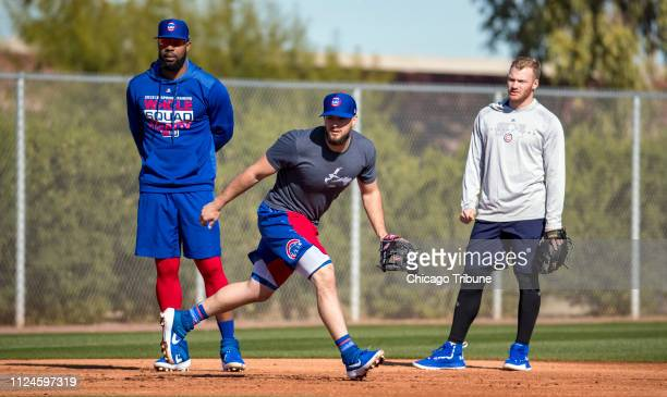 Chicago Cubs players Jason Heyward David Bote and Ian Happ take infield practice on Tuesday Feb 12 2019 as they report to spring training in Mesa Ariz