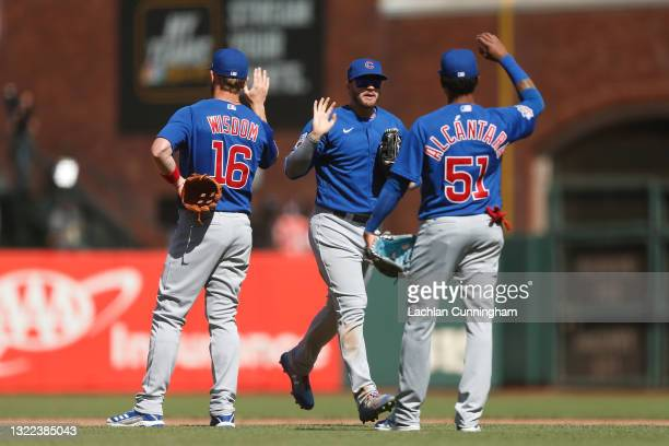 Chicago Cubs players Patrick Wisdom, Ian Happ and Sergio Alcantara celebrate after a win against the San Francisco Giants at Oracle Park on June 06,...