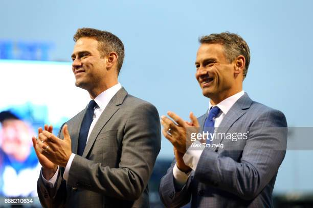 Chicago Cubs President of Baseball Operations Theo Epstein and General Manager Jed Hoyer look on during the World Series ring ceremony ahead of the...