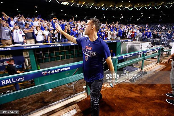 Chicago Cubs President of Baseball Operations Theo Epstein greets fans after the Chicago Cubs defeat the Pittsburgh Pirates to win the National...