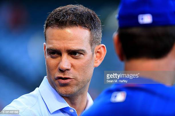 Chicago Cubs President of Baseball Operations Theo Epstein looks on prior to the Opening Day game against the Los Angeles Angels at Angel Stadium of...