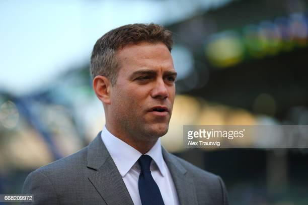 Chicago Cubs President of Baseball Operations Theo Epstein stands on the field during batting practice ahead of the game between the Los Angeles...