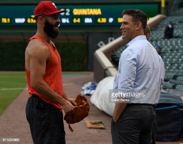 Chicago Cubs President Theo Epstein talks with Jake Arrieta of the Philadelphia Phillies before the game on June 6 2018 at Wrigley Field in Chicago...