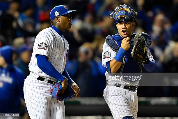 Chicago Cubs relief pitcher Aroldis Chapman and Chicago Cubs catcher Willson Contreras celebrate after the 2016 World Series Game 5 between the...