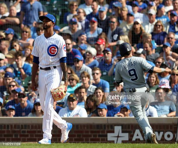 Chicago Cubs relief pitcher Carl Edwards Jr walks back to the mound as San Diego Padres second baseman Luis Urias scores in the ninth inning Sunday...