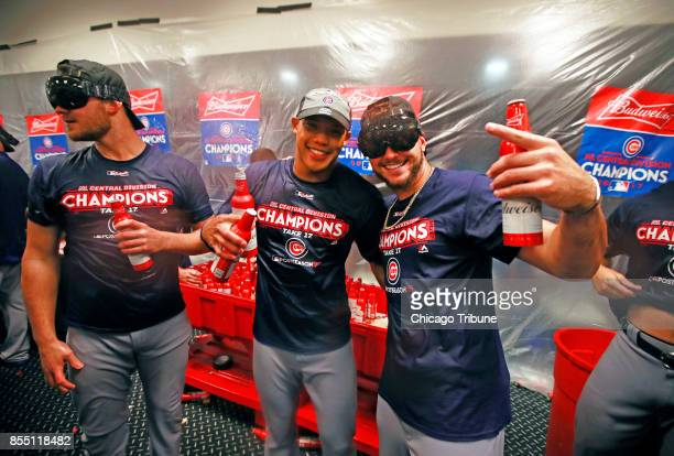 Chicago Cubs relief pitcher Justin Grimm shortstop Addison Russell and center fielder Albert Almora Jr third baseman Kris Bryant celebrate their...