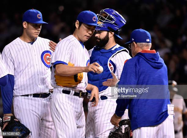 Chicago Cubs relief pitcher Koji Uehara hands the ball to Chicago Cubs manager Joe Maddon after being relieved during the game between the Pittsburgh...