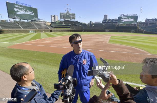 Chicago Cubs relief pitcher Koji Uehara speaks to reporters after a workout at Wrigley Field in Chicago on Sept 29 2017 Uehara said he is recovering...