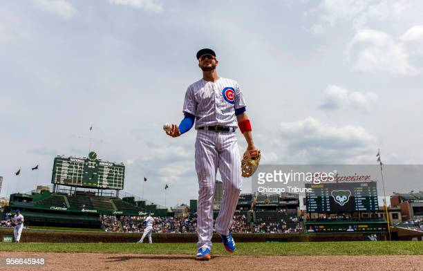 Chicago Cubs right fielder Kris Bryant tosses a baseball to a fan before a game against the Miami Marlins at Wrigley Field in Chicago on Wednesday...