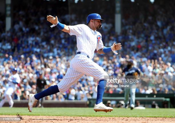 Chicago Cubs right fielder Nicholas Castellanos advances to third base in the second inning Sunday Aug 4 2019 at Wrigley Field in Chicago Ill