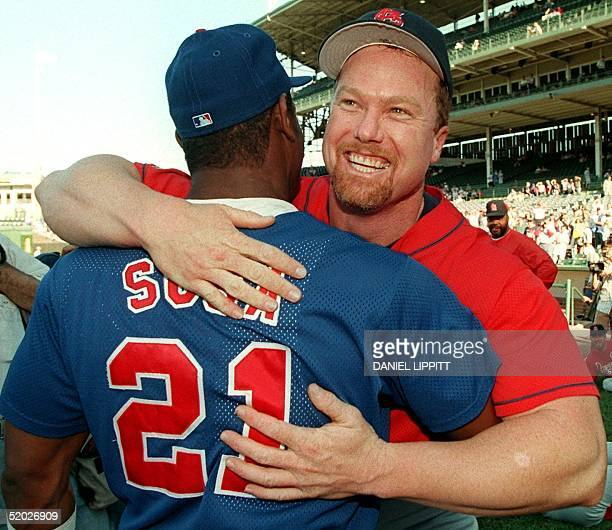Chicago Cubs Sammy Sosa and St Louis Cardinals Mark McGwire say hello before their game 18 August at Wrigley Field in Chicago IL The Cubs later...