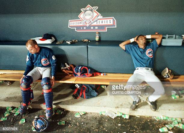 Chicago Cubs Scott Servais and Manny Alexander sit dejected in the Cubs dugout after losing their second divisional playoff game in the 10th inning...