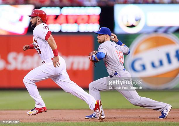 Chicago Cubs second baseman Ben Zobrist right throws ahead to force out St Louis Cardinals' Matt Carpenter at second base on a fielder's choice...