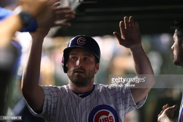 Chicago Cubs second baseman Daniel Murphy is congratulated after scoring off a Ben Zobrist single in the seventh inning against the Cincinnati Reds...