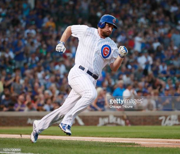Chicago Cubs second baseman Daniel Murphy runs after his double against the New York Mets during the first inning of their game at Wrigley Field...